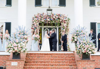 Hannah Lloyd and groom front porch MH